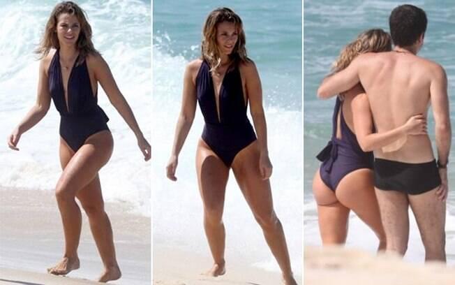 Paola Oliveira exibe suas curvas na praia durante gravação da novela