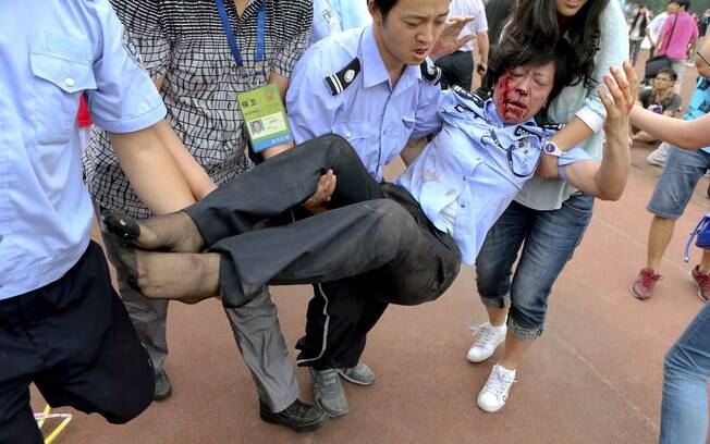 Com o tumulto, cinco pessoas ficaram feridas  na visita de David Beckham a Xangai