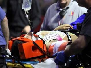 An injured female performer is lifted onto a stretcher after a platform collapsed during an aerial hair-hanging stunt at the Ringling Brothers and Barnum and Bailey Circus, Sunday, May 4, 2014, in Providence, R.I. At least nine performers were seriously injured in the fall, including a dancer below, while an unknown number of others suffered minor injuries. (AP Photo/Providence Journal, Bob Breidenbach)