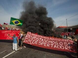 Members of the Homeless Workers Movement protest against the money spent on the World Cup near Itaquerao stadium which will host the international soccer tournament's first match in Sao Paulo, Brazil, Thursday, May 15, 2014. Brazilians are angry at the billions spent to host the World Cup, much of it on 12 ornate football stadiums, one-third of which critics say will see little use after the big event. The banner is a message for Brazil's President Dilma Rousseff. which reads in Portuguese: