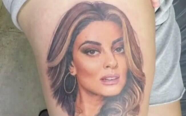 Luiz Herdy fez tatuagem com o rosto da atriz Juliana Paes