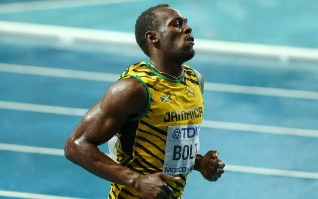 Na chuva, Usain Bolt fez 9s77 na final dos  100m e levou o ouro