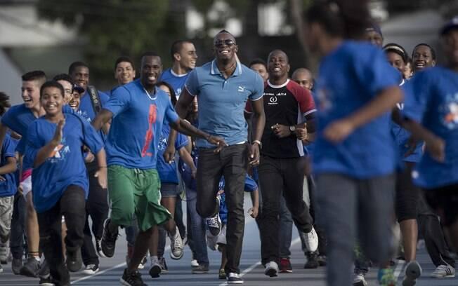 Ele chegou ao Rio no final da semana e, no  primeiro evento, correu ao lado de crianças de um  projeto social no Rio de Janeiro
