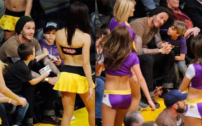 Cheerleaders dançam perto de Beckham e seus filhos