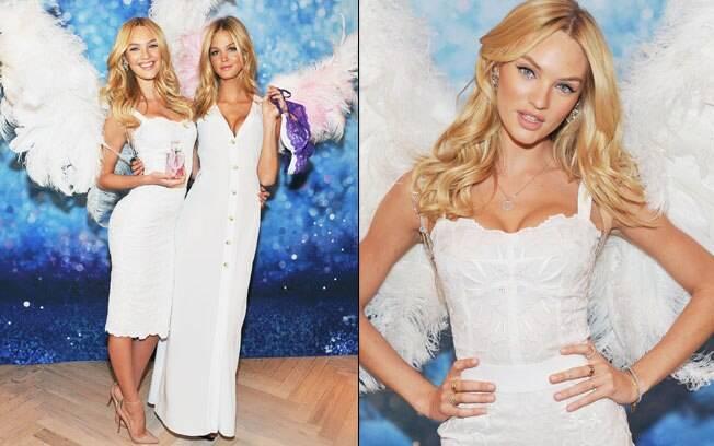 Vestidas de anjo, as tops Candice Swanepoel e Erin Heatherton foram as estrelas do evento