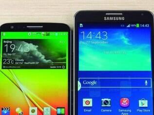 Phablets. Os celulares LG G2 (esq.), com tela de 5,2 polegadas, e o Galaxy Note 3, com tela de 5,7 polegadas, são exemplos da tendência