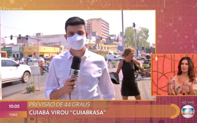 Repórter é interrompido por briga no