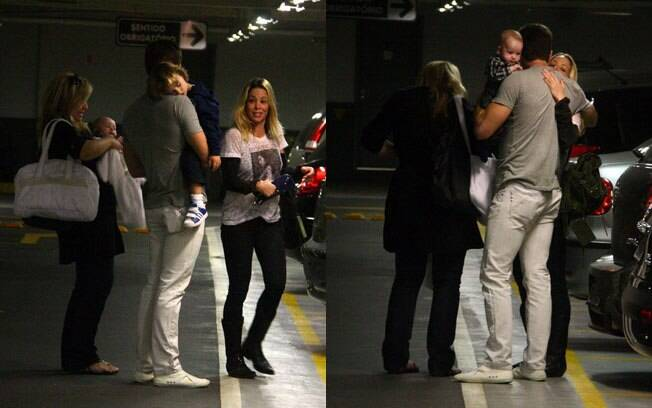 Danielle Winits e Jonatas Faro se despedem no estacionamento
