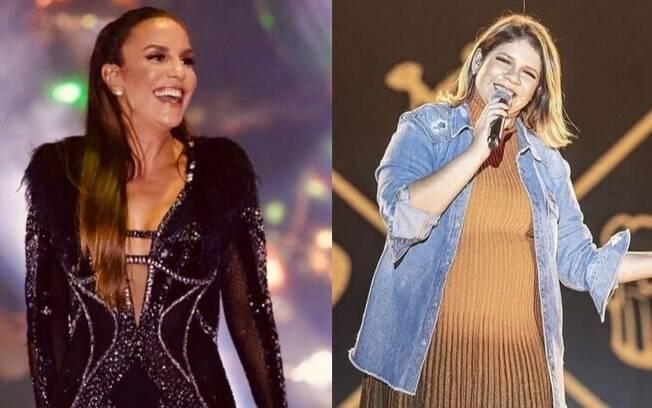 Ivete Sangalo invadiu o palco durante o show de Marília Mendonça e as duas se abraçaram