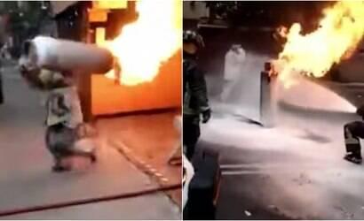 Bombeiro arrisca a vida e retira botijão em chamas de incêndio