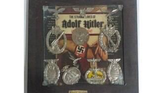 Obra com símbolos nazistas e suposta assinatura de Hitler tem venda proibida