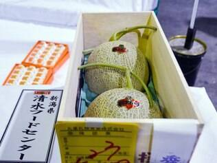 A single pair of Yubari melons with a price of 1.5 million yen (12,400 USD) is displayed at the Sapporo Central Wholesale Market after this year's first auction in Sapporo, Japan's northern island of Hokkaido on May 22, 2015. The winning bid was placed by a local fruit wholesaler for the first Yubari melons to go under the hammer this year.   AFP PHOTO / JIJI PRESS    JAPAN OUT