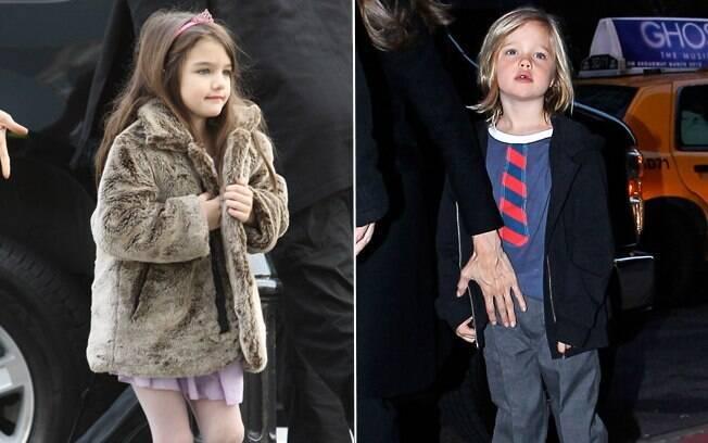 Suri usa tiara, meia calça e casaco de pele, enquanto Shiloh aparece de camiseta com costura de gravata: estilos opostos delineiam perfis que costumam preocupar os pais