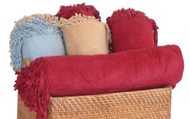 Mantas para o sof decoram e aquecem decora o ig for Mantas para sofas