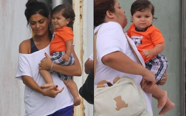 Pedro no colo de Juliana Paes e, em seguida, com a babá