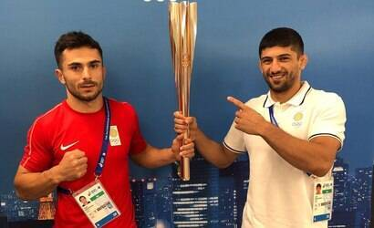 Medalhistas são expulsos das Olimpíadas por saírem da Vila