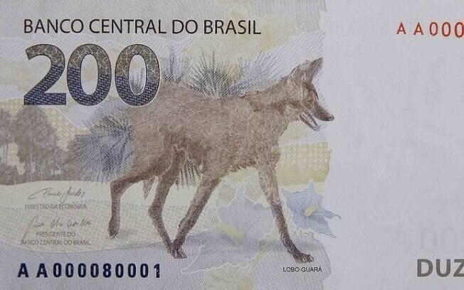 Nota de R$ 200, de cor cinza e detalhes em sépia, é representada pelo lobo-guará