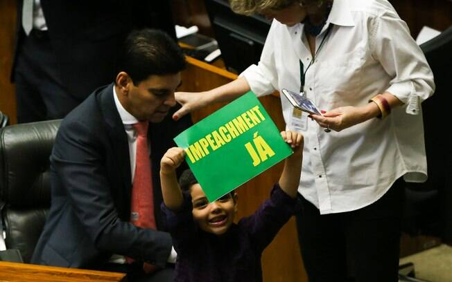 Criança participa de sessão da votação na Câmara. Foto: Marcelo Camargo/ Agência Brasil - 17.04.16