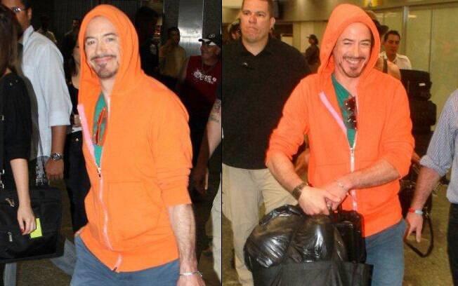 Robert Downey Jr desembarca no aeroporto Galeão, no Rio: simpatia com os fãs e os fotógrafos