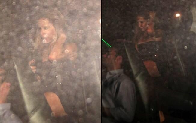 Ana Paula Junqueira tentando se esconder dos flashes