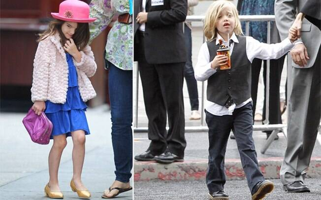 Suri de bolsa e sapato alto e Shiloh de colete e gravata: rótulos de