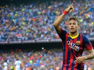 FC Barcelona's Neymar reacts after scoring against Real Madrid during a Spanish La Liga soccer match at the Camp Nou stadium in Barcelona, Spain, Saturday, Oct. 26, 2013. (AP Photo/Manu Fernandez)