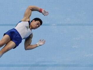 Brazil's Sergio Junior Sasaki competes in the floor exercise during the all-around final at the Artistic Gymnastics World Championships in Antwerp, Belgium, Thursday, Oct. 3, 2013. The event runs until Sunday, Oct. 6.   (AP Photo/Yves Logghe)