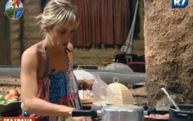 Anna Markun prepara almoço para o grupo