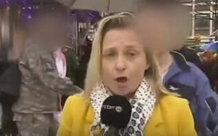 Repórter é assediada durante transmissão ao vivo no carnaval alemão - Mundo - iG
