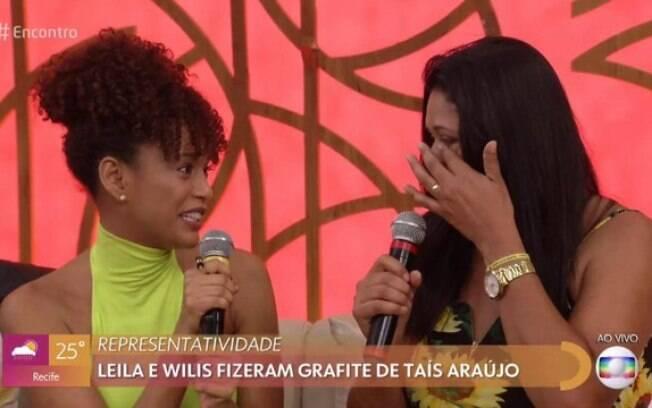 Taís Araújo conhece Leila, que grafitou rosto da atriz no Guarujá