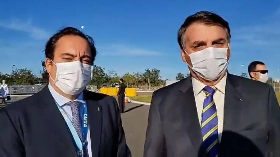 Pedro Guimarães, presidente da Caixa, ao lado de Jair Bolsonaro