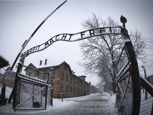 The entrance to the former Nazi concentration camp Auschwitz-Birkenau with the lettering 'Arbeit macht frei' ('Work makes you free') is pictured in Oswiecim, Poland on January 25, 2015, days before the 70th anniversary of the liberation of the camp by Russian forces. AFP PHOTO / JOEL SAGET