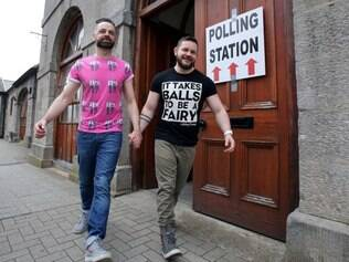 A gay couple pose holding hands as they walk out of a polling station after voting in Drogheda, north Dublin on May 22, 2015. Ireland took to the polls today to vote on whether same-sex marriage should be legal, in a referendum that has exposed sharp divisions between communities in this traditionally Catholic nation.   AFP PHOTO / Paul Faith