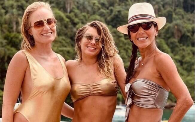 Angélica posa para foto ao lado de Carolina Dieckmann e a estilista Lica Melzer