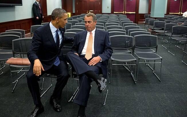 Líder dos EUA conversa com presidente da Câmara, republicano John Boehner, no Capitólio (23/3/2013)