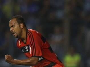 Brazil's Flamengo Alecsandro celebrates after scoring a penalty against Ecuador's Emelec at a Copa Libertadores soccer match in Guayaquil, Ecuador, Wednesday, April 2, 2014. (AP Photo/Dolores Ochoa)