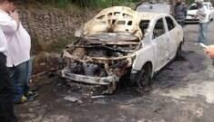 """Taxista acusa """"homens ligados ao Uber"""" de incendiarem seu carro"""