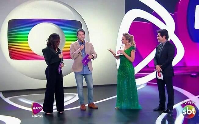 A Globo anunciou em sua programação os números de telefone para doações para o Teleton, do SBT