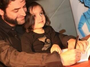 Renato e Lucia no lançamento do livro: ele se preparou para ser pai de menina