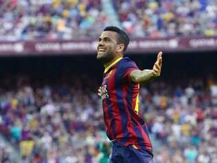 FC Barcelona's Daniel Alves, from Brazil, reacts after scoring against Levante during a Spanish La Liga soccer match at the Camp Nou stadium in Barcelona, Spain, Sunday, Aug. 18, 2013. (AP Photo/Manu Fernandez)