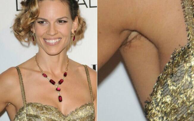 Hillary Swank prova que os pelos debaixo do braço não tiram o glamour de seu look. Ou não?