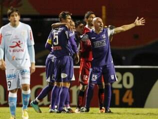 Uruguay's Defensor Sporting players celebrate their 2-0 victory at the end of a Copa Libertadores soccer match with Peru's Real Garcilaso in Huancayo, Peru, Tuesday, April 1, 2014. (AP Photo/Martin Mejia)