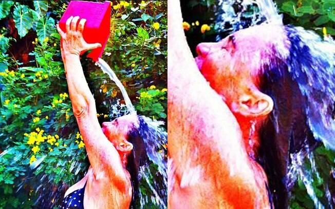 De biquíni, Regina Duarte publica foto tomando banho de balde