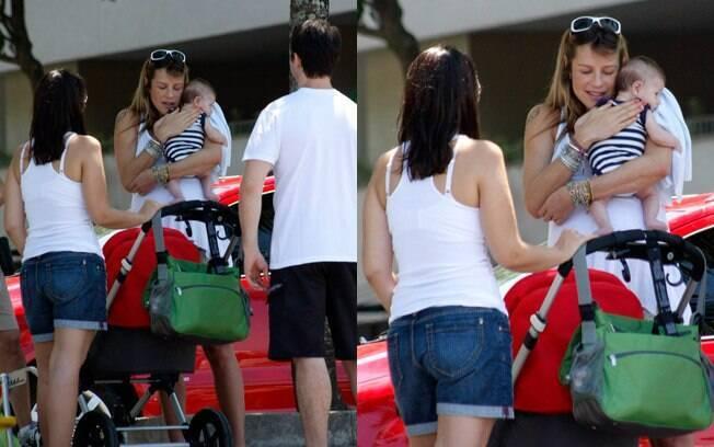 Luana Piovani curte praia com marido Pedro Scooby e se encanta com bebê de casal