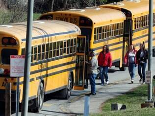 Students walk past a row of buses as they leave the campus of the Franklin Regional School District after more then a dozen students were stabbed by a knife wielding suspect at nearby Franklin Regional High School on Wednesday, April 9, 2014, in Murrysville, Pa., near Pittsburgh. The suspect, a male student, was taken into custody and is being questioned. (AP Photo/Gene J. Puskar)