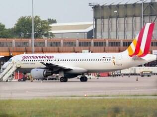 (FILES) A photo taken on August 29, 2014 at Berlin's Tegel airport shows an Airbus 320 aircraft of Lufthansa's low-cost subsidiary Germanwings. A German-owned Airbus A320 plane that crashed in the French Alps on March 24, 2015 had 148 people onboard including six crew members, a civil aviation official said. The official said there had been