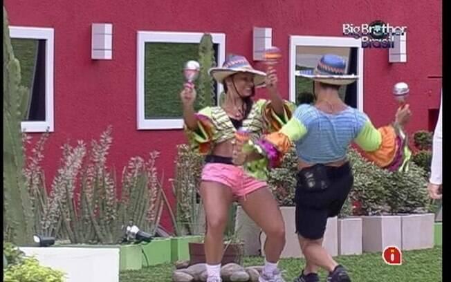Kelly e Yuri atacam de mariachis. Os dois dançam com suas maracas quando a música toca