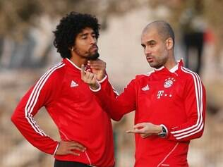 Bayern head coach Pep Guardiola of Spain, right, talks to Dante of Brazil during a training session at the Club World Cup soccer tournament in Agadir, Morocco, Sunday, Dec. 15, 2013. Bayern Munich will face Guangzhou Evergrande in the first semi final on Tuesday, Dec 17. (AP Photo/Matthias Schrader)