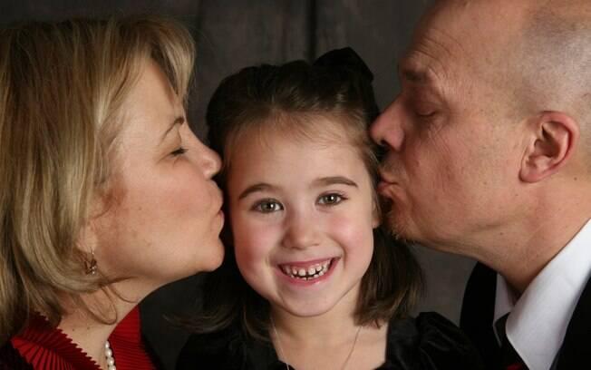 O casal Lancaster e a filha Elisha, de 8 anos: sonho realizado