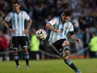 Argentina's Lionel Messi kicks the ball during an international friendly soccer match with Slovenia in La Plata, Argentina, Saturday, June 7, 2014. Argentina's team is leaving June 9 for Brazil to compete in the World Cup. (AP Photo/Eduardo Di Baia)
